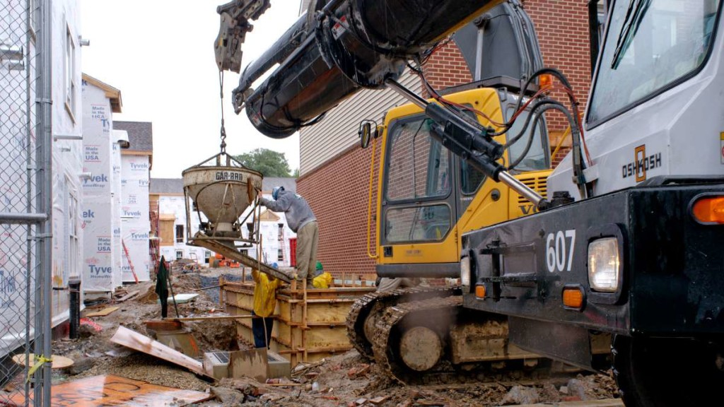 Crews pour concrete at Queen Lane Apartments. (Bastiaan Slabbers/for NewsWorks)